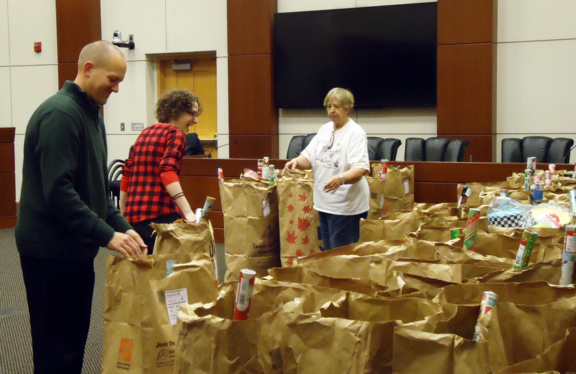 Volunteers check bags of gifts in the township boardroom