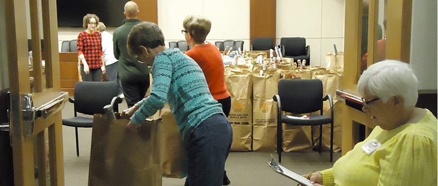 volunteers organize gifts and toys into bags